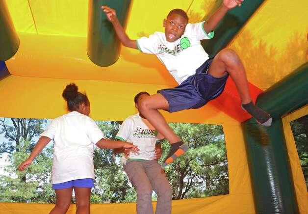 Daheem Wilson, 9, of Troy jumps high in the bouncy bounce during the 15-LOVE program at this yearOs Jamboree in Washington Park on Thursday, Aug. 13, 2015 in Albany, N.Y.  (Lori Van Buren / Times Union) Photo: Lori Van Buren / 00032989A