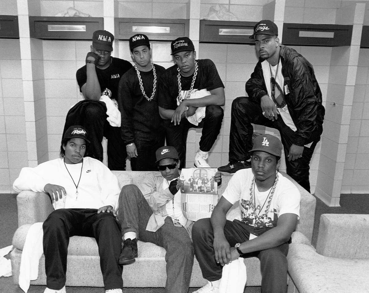 KANSAS CITY - JUNE 1989: Rap group N.W.A. pose with rappers The D.O.C. and Laylaw from Above The Law (L-R standing: Laylaw, DJ Yella, Dr. Dre and The D.O.C. seated Ice Cube, Eazy-E and MC Ren)backstage at the Kemper Arena during their 'Straight Outta Compton' tour in June 1989 in Kansas City, Missouri.