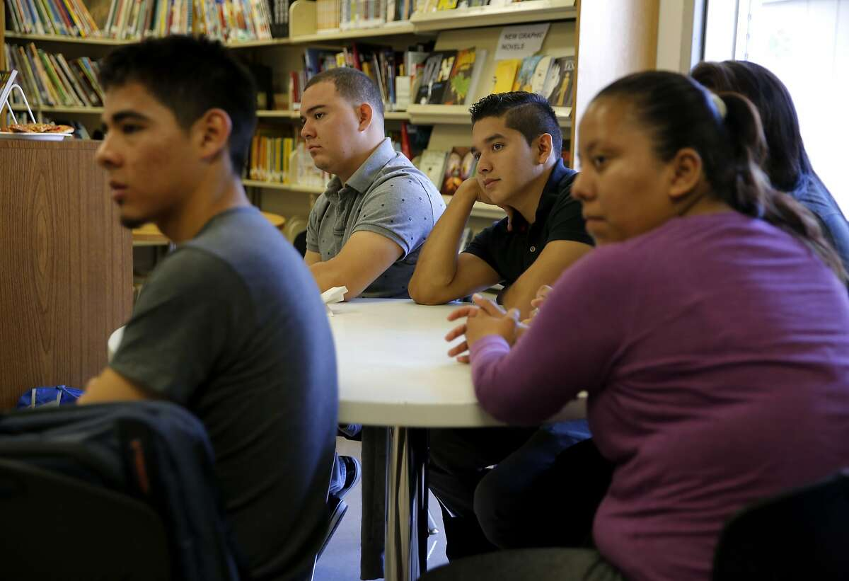Kevin Galvez, Lester Romero, Jose Navarro Rodriguez and Brenda Gonzalez (from left) listen to information about a summer program at San Francisco International High School while at the school in San Francisco, California, on Thursday, Aug. 13, 2015.