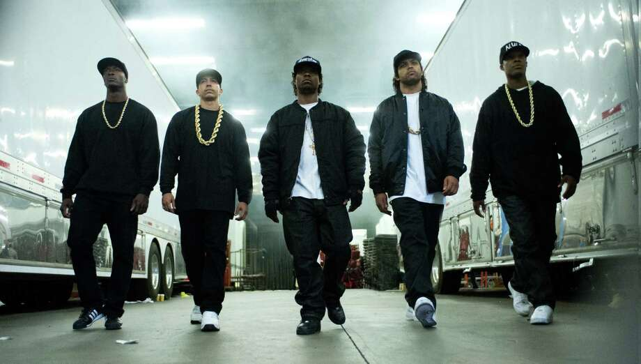 """This photo provided by Universal Pictures shows, Aldis Hodge, from left, as MC Ren, Neil Brown, Jr. as DJ Yella, Jason Mitchell as Eazy-E, O'Shea Jackson, Jr. as Ice Cube and Corey Hawkins as Dr. Dre, in the film, """"Straight Outta Compton."""" The movie releases in U.S. theaters on Aug. 14, 2015. (Jaimie Trueblood/Universal Pictures via AP) ORG XMIT: CAET668 Photo: Jaimie Trueblood / Universal Pictures"""