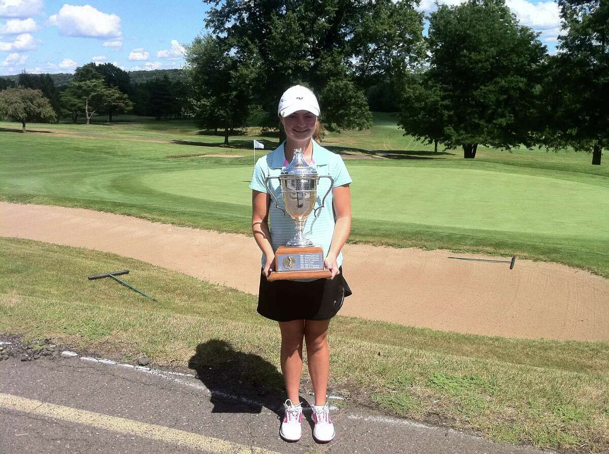 Catherine McEvoy of Greenwich holds the trophy after winning the 50th Connecticut State Women's Amateur Championship at Indian Hill Country Club in Newington, Connecticut on Thursday.