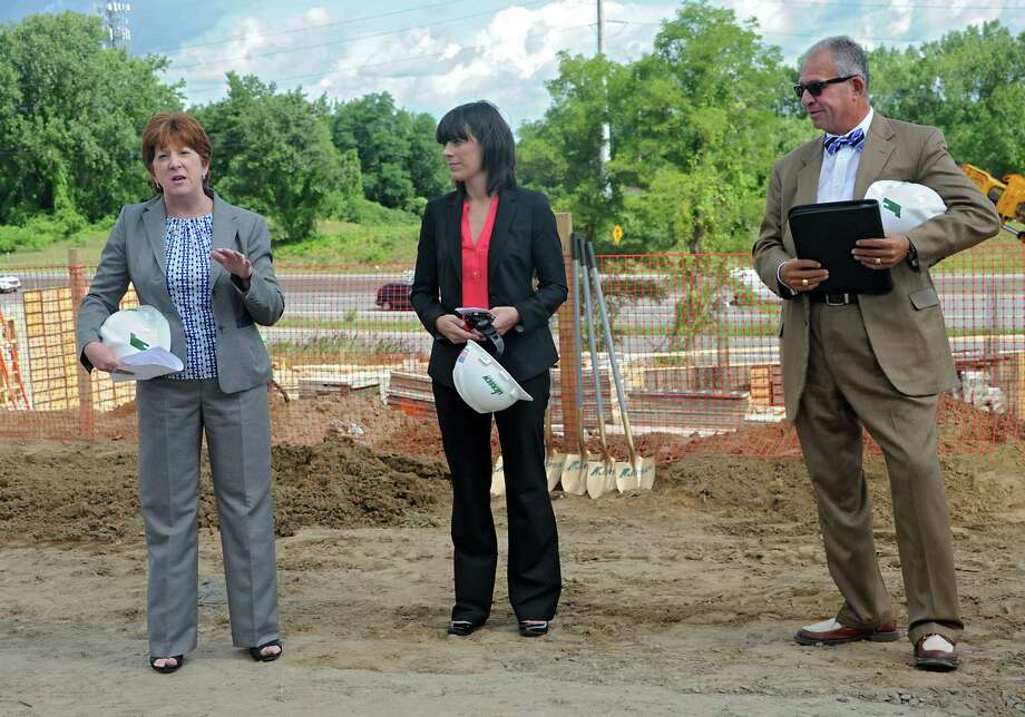 From left, Albany Mayor Kathy Sheehan, Sarah Reginelli, president of Capitalize Albany Corp., and Jon Grant of GSX Solutions all took turns talking during a groundbreaking for University Suites at SUNY Albany at 1475 Washington Ave. on Thursday, Aug. 13, 2015 in Albany, N.Y. The privatized student housing project seeks to house 277 full time students or staff from any area college. (Lori Van Buren / Times Union) Photo: Lori Van Buren / Albany