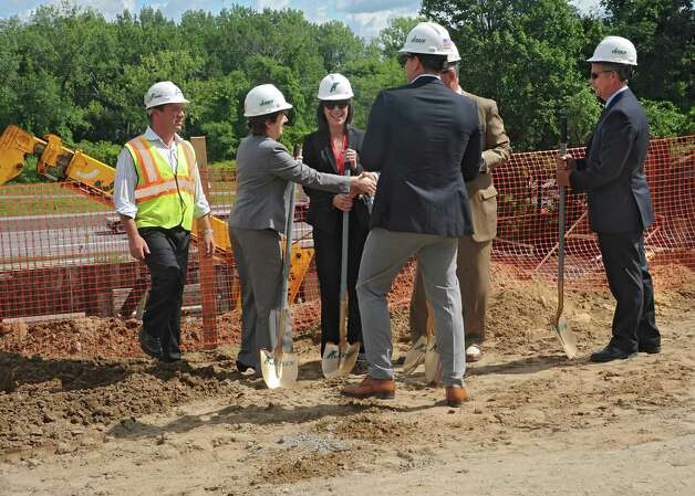 Albany Mayor Kathy Sheehan shakes hands with building company officials during a groundbreaking for University Suites at SUNY Albany at 1475 Washington Ave. on Thursday, Aug. 13, 2015 in Albany, N.Y. The privatized student housing project seeks to house 277 full time students or staff from any area college. (Lori Van Buren / Times Union) Photo: Lori Van Buren / Albany