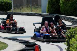 Riders enjoy the go karts at Malibu Grand Prix on Tuesday, Aug. 11, 2015. The park will be closing soon. It opened in 1978.