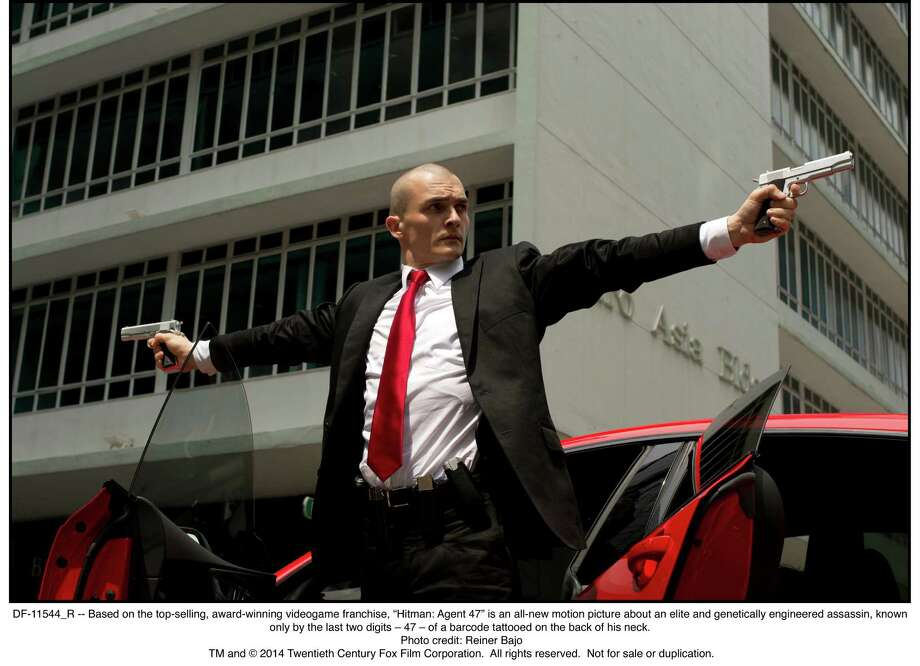 """Rubert Friend is Agent 47, a genetically engineered assassin, in """"Hitman: Agent 47."""" Based on the top-selling, award-winning video-game franchise, """"Hitman: Agent 47"""" is a new motion picture about an elite assassin known only by the last two digits — 47 — of a barcode tattooed on the back of his neck. Photo: 20th Century Fox / TM and © 2014 Twentieth Century Fox Film Corporation.  All rights reserved.  Not for sale or duplication."""