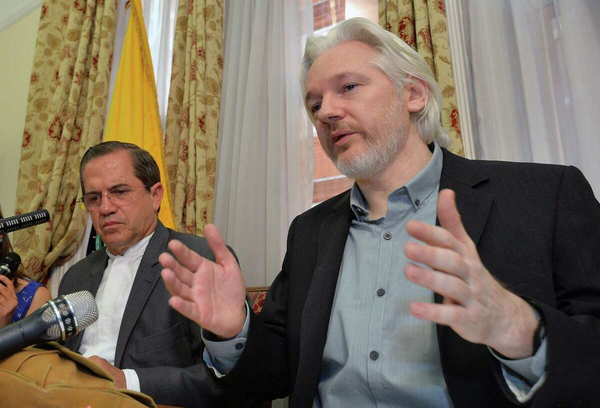 FILE - In this Aug. 18, 2014, file photo, WikiLeaks founder Julian Assange, right, speaks during a news conference with Ecuador's Foreign Minister Ricardo Patino, inside the Ecuadorian Embassy in London. (John Stillwell/Pool Photo via AP, File)