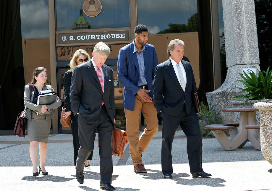 Tim Duncan exits proceedings with his legal team after he makes an appearance in federal court before U.S. District Judge Xavier Rodriguez regarding his lawsuit against Charles Banks in June. From left are attorney Jacqueline Garza-Rothrock, consultant Wendy Kowalik, attorney J. Tullos Wells, Duncan and attorney Michael D. Bernard. Photo: Tom Reel /San Antonio Express-News