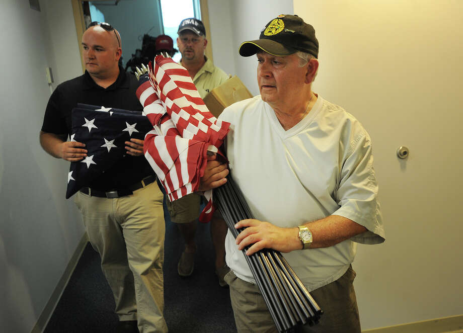 From left; Veterans Greg Lovisolo, of Naugatuck, Richard Dziekan, of Derby, and Bob Federico, of Derby, donate American flags for Derby City Hall and to replace tattered flags on Main Street at City Hall in Derby, Conn. on Thursday, August, 13, 2015. Photo: Brian A. Pounds / Hearst Connecticut Media / Connecticut Post