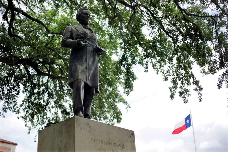 A statue of Jefferson Davis is seen on the University of Texas campus in Austin, Texas. The president of the University of Texas has ordered removing the statue of Davis from the center of campus, but statues of other Confederate figures will stay. The Davis statue has been targeted by vandals and had come under increasing criticism.   (AP Photo/Eric Gay, file) Photo: Eric Gay, STF / AP