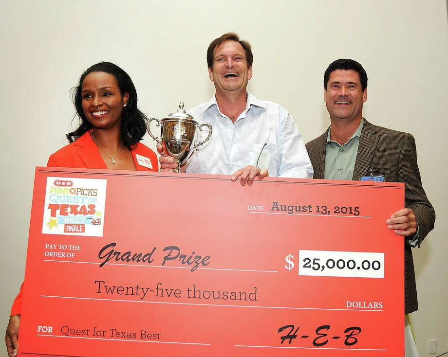 Grand-prize winner Matthew Lee of Austin can't contain his excitement after winning $25,000 at the HEB Quest for Texas Best awards ceremony at the Houston Food Bank August 13, 2015. Also pictured are Winell Herron and Reade Ahrens from HEB.(Dave Rossman photo) Photo: Dave Rossman, Freelance / Freelalnce