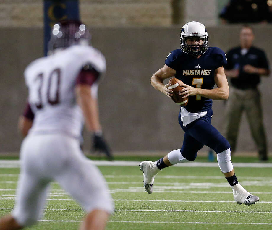 Cy Ranch's QB Collin Rock (7) runs the ball during the first half of action between Cy-Fair and Cy Ranch high schools during a football game at the Berry Center, Thursday, Oct. 30, 2014, in Houston.  ( Karen Warren / Houston Chronicle  ) Photo: Karen Warren, Staff / © 2014 Houston Chronicle