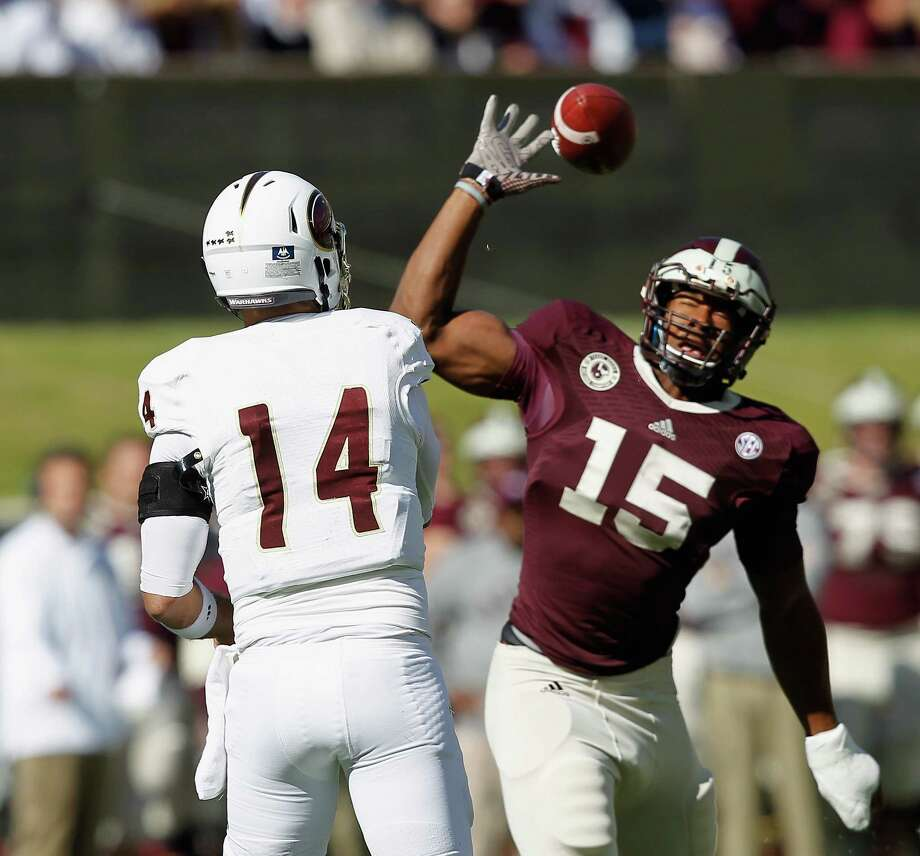Pete Thomas of the Louisiana Monroe Warhawks throws over Myles Garrett of the Texas A&M Aggies at Kyle Field on November 1, 2014 in College Station, Texas. Photo: Bob Levey /Getty Images / 2014 Getty Images