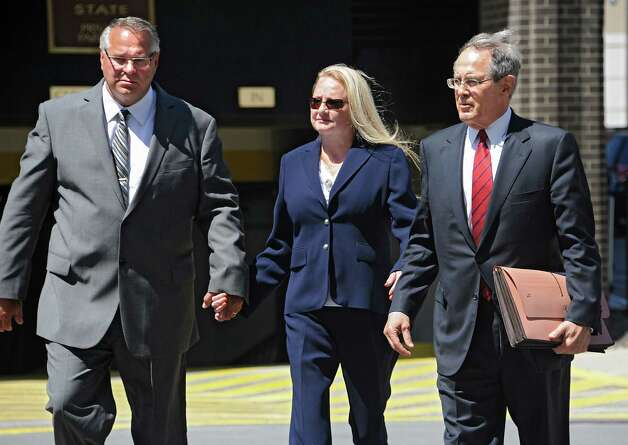 Former Halfmoon Supervisor Melinda Wormuth and her husband Larry Wormuth arrive at the US District Courthouse with her attorney E. Stewart Jones on Monday, Aug. 10, 2015 in Albany, N.Y. Melinda was arrested for bribery, extortion and lying to FBI agents in a political corruption investigation. (Lori Van Buren / Times Union) Photo: Lori Van Buren / 00032952A