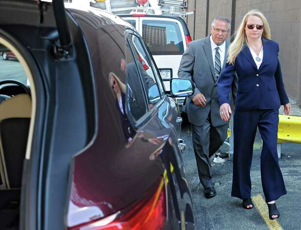 Former Halfmoon Supervisor Melinda Wormuth and her husband Larry Wormuth leave the US District Courthouse on Monday, Aug. 10, 2015 in Albany, N.Y. Melinda pleaded guilty on two felony charges. (Lori Van Buren / Times Union) Photo: Lori Van Buren / 00032952A