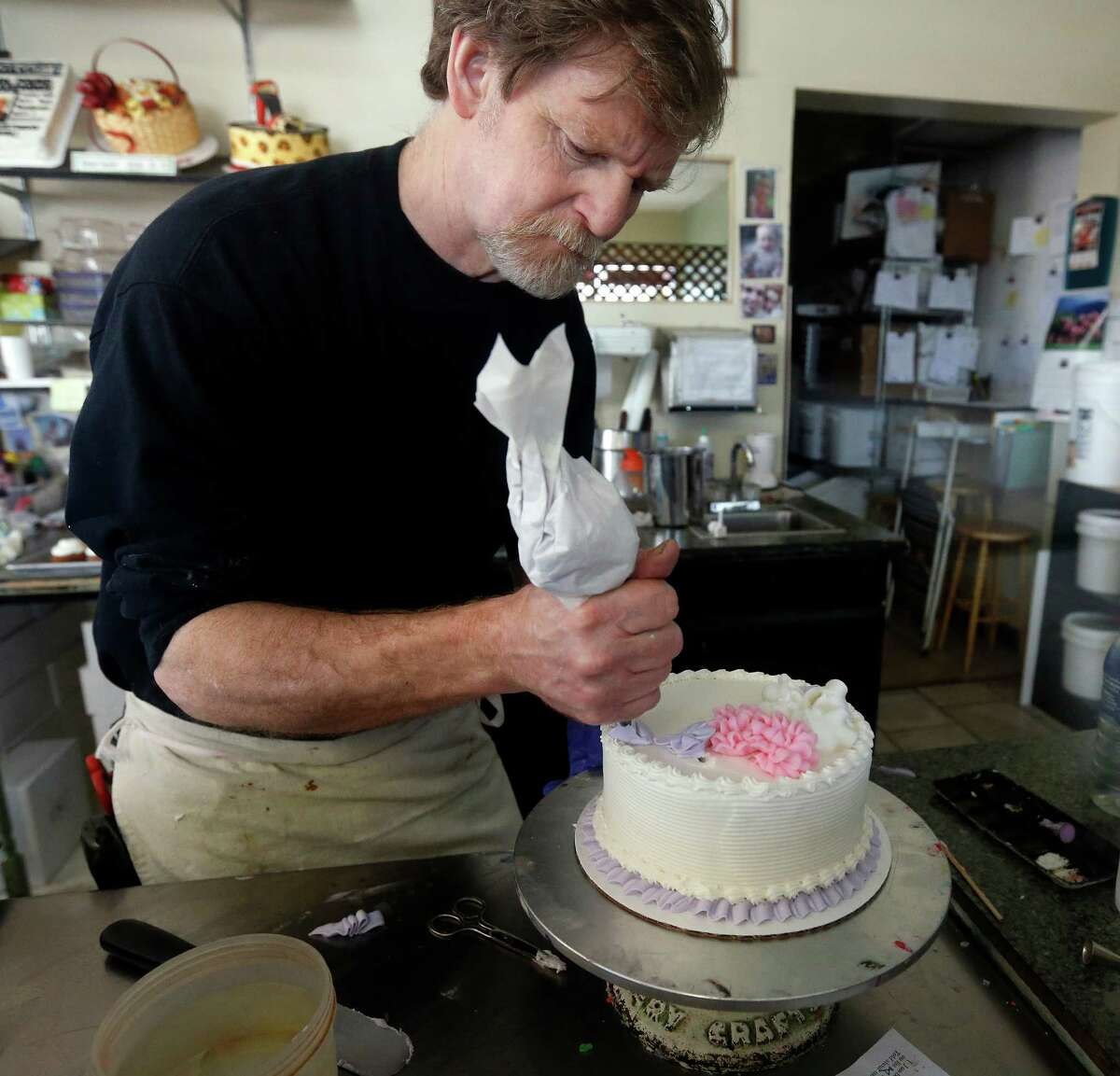 FILE - In this March 10, 2014 file photo, Masterpiece Cakeshop owner Jack Phillips decorates a cake inside his store, in Lakewood, Colo. Phillips a suburban Denver baker who wouldn't make a wedding cake for a same-sex couple cannot cite his religious beliefs in refusing them service because it would lead to discrimination, the Colorado Court of Appeals ruled Thursday, Aug. 13, 2015. (AP Photo/Brennan Linsley, File)