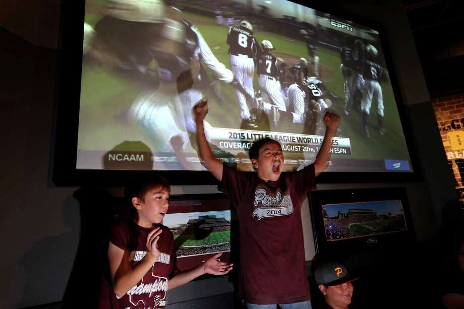 Little League players Juan Enriquez, 9, left, Armando Robles Jr., 10, and Blake Weaver, 10, react to the final out while watching the big screen as Pearland West Little League defeated Colorado 9-2 in the Southwest Regional final in Waco at a viewing party at Buffalo Wild Wings Thursday, Aug. 13, 2015, in Pearland, Texas. Pearland won 9-2 advancing to the Little League World Series in Williamsport, Pa. Photo: Gary Coronado, Houston Chronicle / © 2015 Houston Chronicle