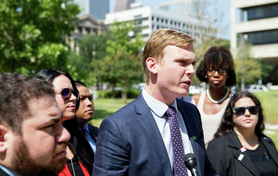 Jason Miller of the National Organization for the Reform of Marijuana Laws calls for Harris County Sheriff Ron Hickman to take action against sheriff's deputies who forcibly conducted a body cavity search on a Spring woman. Photo: Cody Duty, Staff / © 2015 Houston Chronicle
