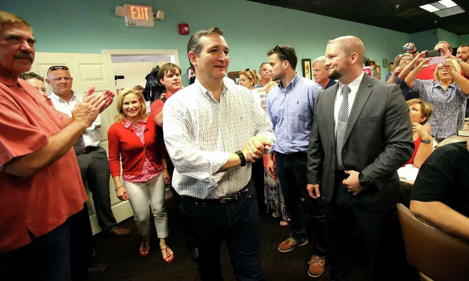 Republican presidential candidate Ted Cruz arrives to a cheering and standing room only crowd at Sweetpea's restaurant in Olive Branch, Miss., Tuesday, Aug. 11, 2015. (Stan Carroll/The Commercial Appeal) Photo: Stan Carroll, Associated Press / The Commercial Appeal