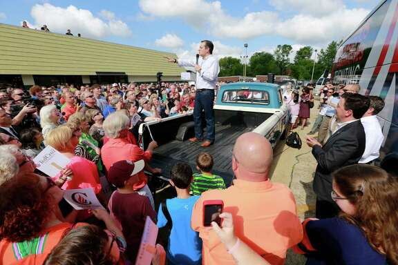 Republican presidential candidate Ted Cruz speaks to supporters from the bed of a pick up truck during a tour stop, Tuesday, Aug. 11, 2015 in Tupelo, Miss. (Thomas Wells/Northeast Mississippi Daily Journal via AP)