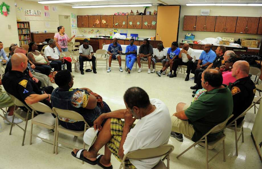 Local residents, police and officials gather for the East End Neighborhood Revitalization Zone (NRZ) meeting at the Ralphola Taylor Center on Central Avenue in Bridgeport, Conn., on Thursday Aug. 13, 2015. The meeting which was led by Bridgeport City Councilwoman Eneida Martinez, D-139 and NRZ Vice-President Lillian Wade, focused on solutions to the recent spike in violence in the East End. Photo: Christian Abraham / Hearst Connecticut Media / Connecticut Post