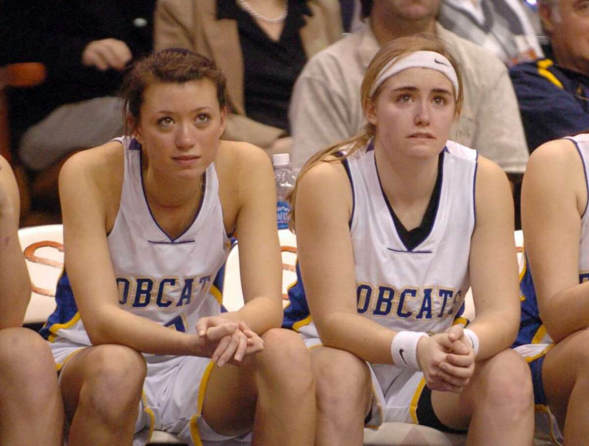 Brookfield 12, Jacklyn Brown and 20, Brittany Martelle, watch their teammates during the final moments of the championship girls basketball game against Kolby at Mohegan Sun, Friday, March 19, 2010.
