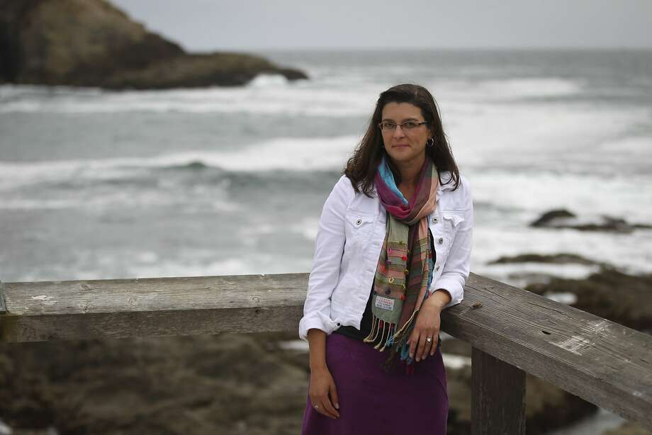 Dr. Tessa Hill poses for a portrait outside the UC Davis marine lab at Bodega Bay, Calif., on Friday, July 17, 2015. Hill and her colleagues use the lab facilities to study the effects of ocean acidification on shellfish like oysters. Photo: Loren Elliott, The Chronicle
