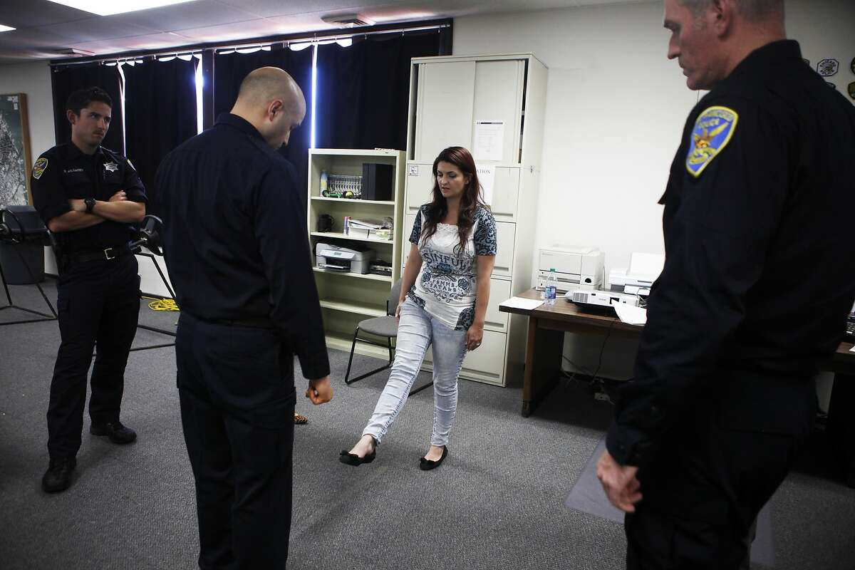 Jaime Enea, a volunteer participating in the San Francisco Police Department's