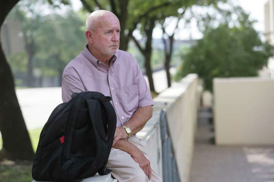 Jim Royall waits for the number 18 at McKinney Street and Bagby Street Thursday, Aug. 13, 2015, in Houston. Metro will do away with this route, and a few others, with the upcoming route changes scheduled to begin Sunday. Photo: Jon Shapley, Houston Chronicle / © 2015 Houston Chronicle