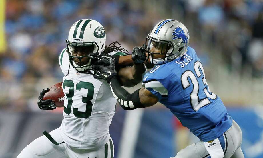 New York Jets running back Chris Ivory (33) stiff-arms Detroit Lions cornerback Darius Slay (23) during the first half of an NFL preseason football game, Thursday, Aug. 13, 2015, in Detroit. (AP Photo/Rick Osentoski) ORG XMIT: DTF107 Photo: Rick Osentoski / FR170444 AP