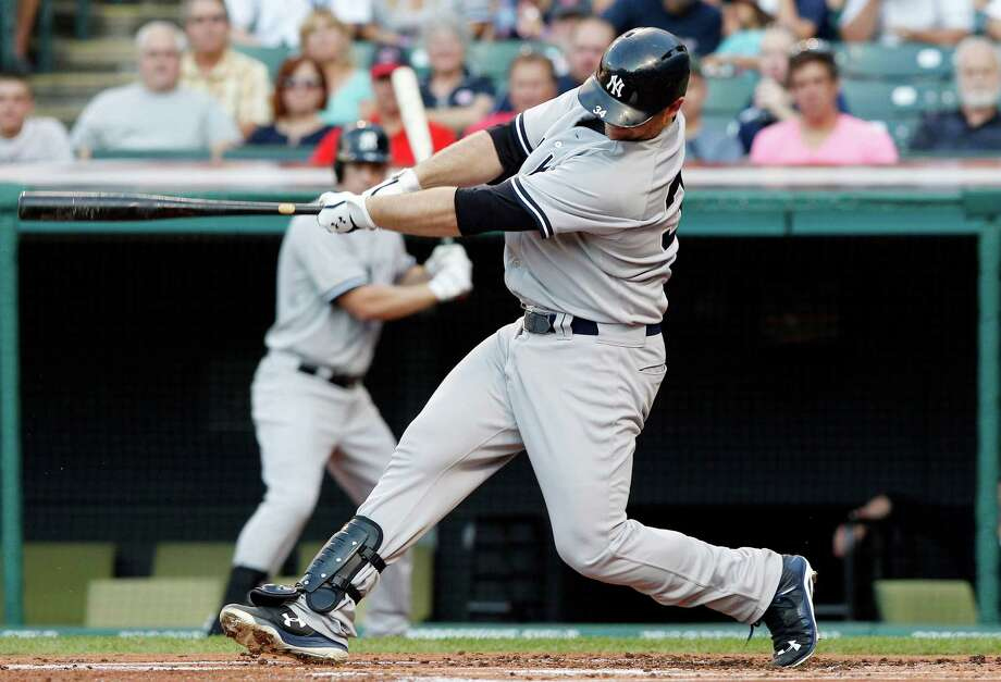 CLEVELAND, OH - AUGUST 13:  Brian McCann #34 of the New York Yankees hits a three run home run against the Cleveland Indians during the first inning of their game on August 13, 2015 at Progressive Field in Cleveland, Ohio.    (Photo by David Maxwell/Getty Images) ORG XMIT: 538589625 Photo: David Maxwell / 2015 Getty Images