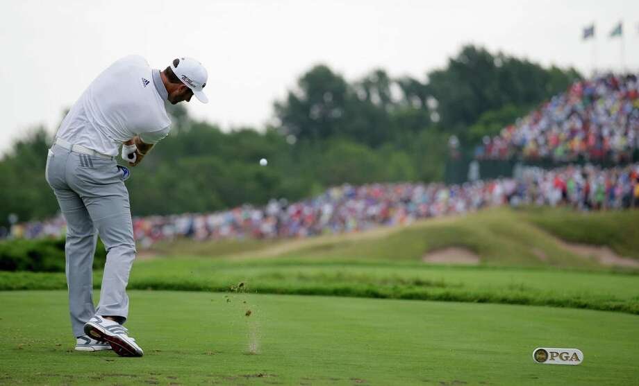 Dustin Johnson hits a tee shot on the 17th hole during the first round of the PGA Championship golf tournament Thursday, Aug. 13, 2015, at Whistling Straits in Haven, Wis. (AP Photo/Jae Hong)  ORG XMIT: PGA189 Photo: Jae Hong / AP