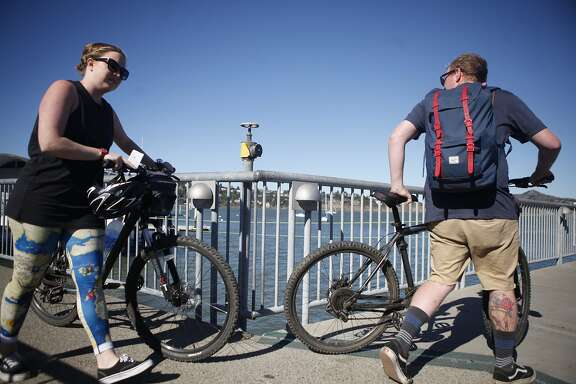 With the increase of tourist bikes, ferries are being backed up and struggling to keep up.  Sarah Oliver, 26, and Mark Nalder, 25, make their way to board the Golden Gate Sausalito Ferry with their rental bikes on Thursday, Aug. 13, 2015.
