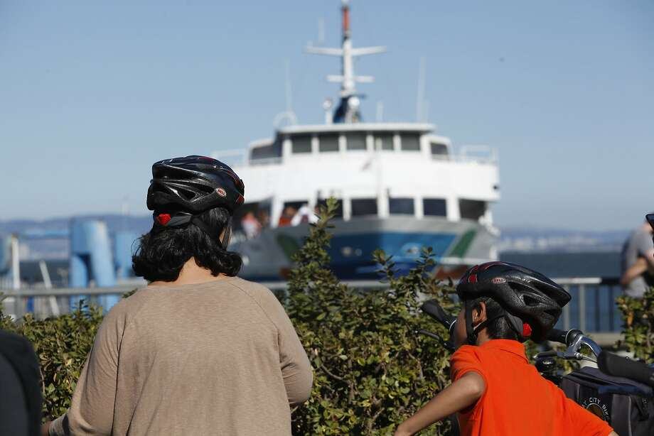 With the increase of tourist bikes, ferries are being backed up and struggling to keep up. Tour bike renters await to board the Golden Gate Sausalito Ferry. . Photo: Cameron Robert, The Chronicle