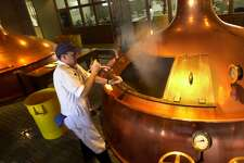 Employee works at the Anchor Brewing's copper kettles.  Photo: 2010