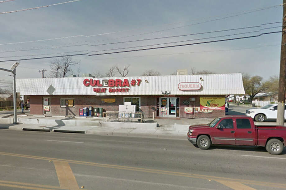 Culebra Meat Market #7: 3017 Blanco Road, San Antonio, Texas 78201Date: 07/05/2016 Score: 83Highlights: Dried blood seen on shelves inside cooler, Ozarka plastic container used as a dispenser for marinade, dented cans must be removed from consumption supply, no soap or paper towels in carnitas preparation area, employees' bottled sodas stored near consumer products (various meats) within meat display cooler Photo: Google Street View/Maps