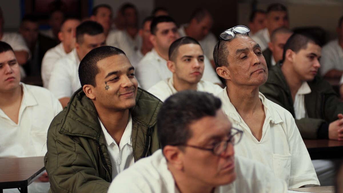 Inmates participate in the
