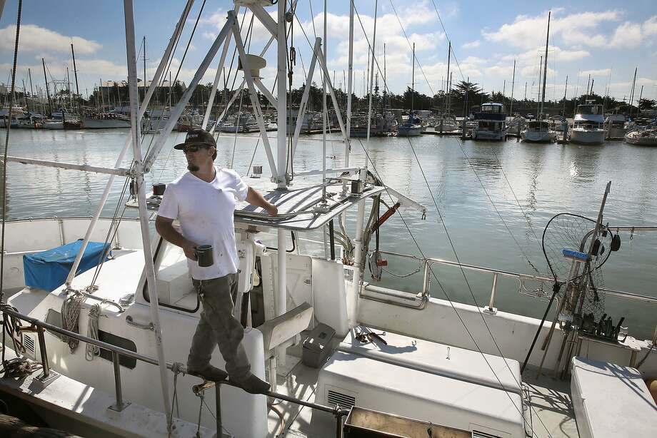 Commercial fisherman and dock hand Jerid Rold works on his boat at Moss Landing, Calif., on Thursday, August 13, 2015. Photo: Liz Hafalia, The Chronicle