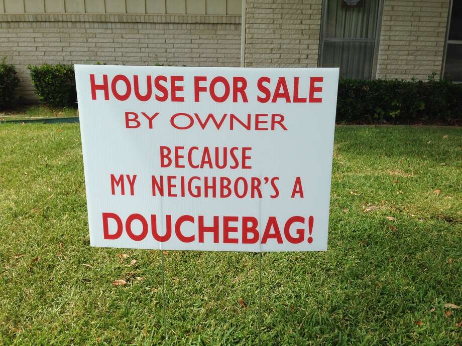 A Farmers Branch couple put this sign in their front yard after tensions with their nextdoor neighbors heated up over barking dogs, Aug. 14, 2015. (Courtesy of James Price)PHOTOS: See 13 more homes and real estate additions done completely out of spite for the neighbors ...