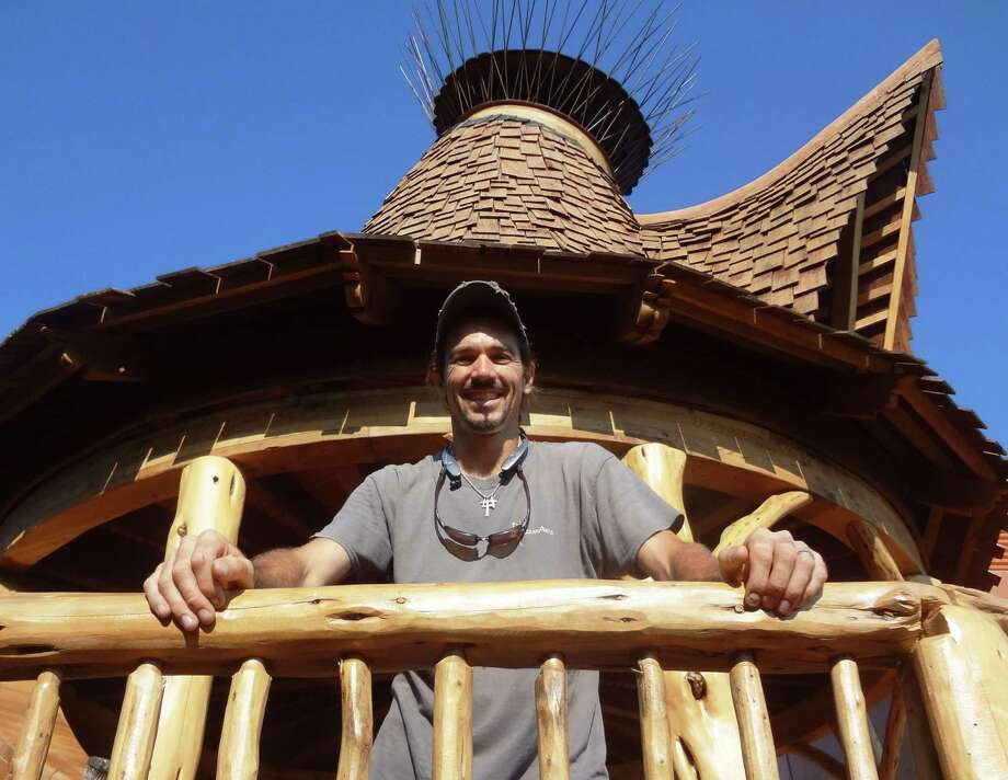 San Antonio wood artisan Attie Jonker spent a year and a half on design and engineering for the DoSeum Treehouse; then he and his nine-man crew from Azzanarts built the one-of-a-kind structure over the past seven months. Photo: Photo By Steve Bennett /Photo By Steve Bennett