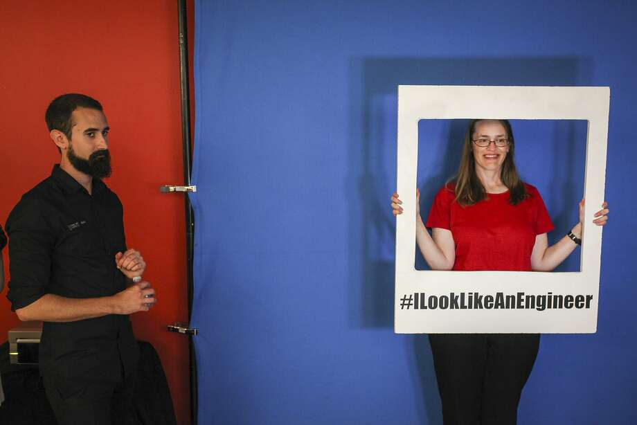 Shifra Raffel, an MSCI employee, gets her picture taken at the event, inspired by the #ILookLikeAnEngineer hashtag, as Ben Lee looks on. Below: Amy Chantasirivisal (left), Sydney Richardson and Paridhi Agarwala, pose for photos. Photo: Sam Wolson, Special To The Chronicle