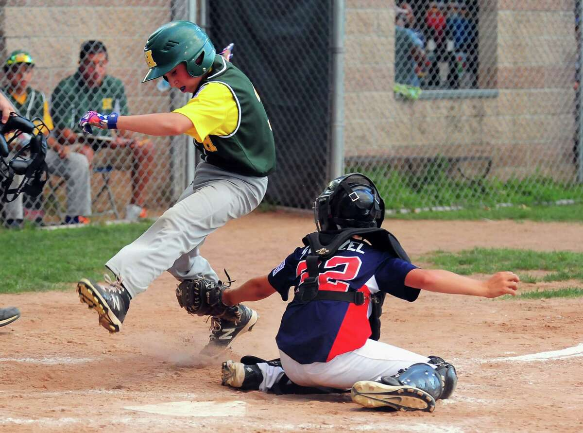 Stamford North catcher Andrew Stietzel tags out Hamden's Max Gross at home plate, during little league tournament action at Scalzi Park in Stamford, Conn., on Friday July 24, 2015.