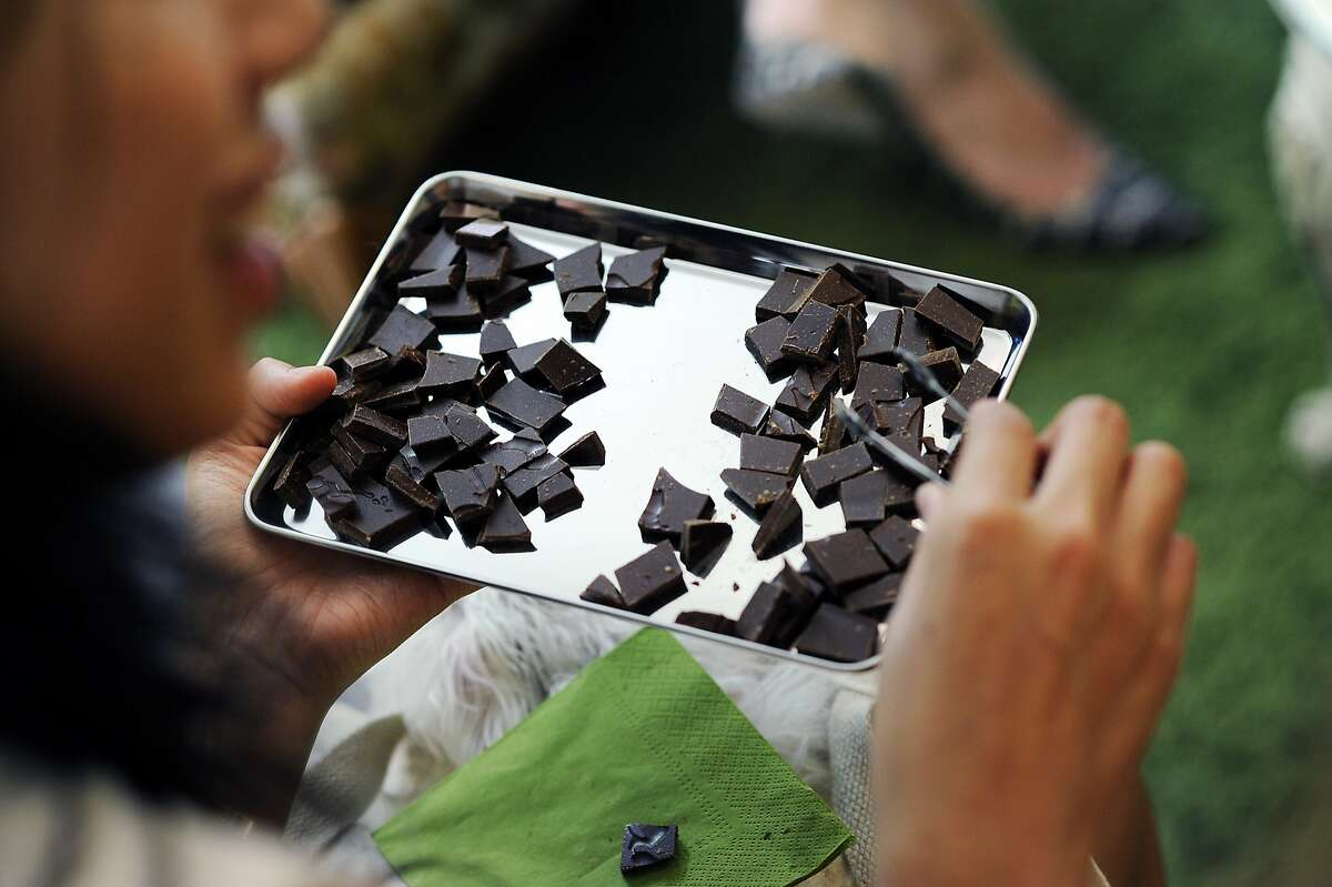 Members of the marketing team for fashion and shopping website Polyvore, try a selection of chocolates during a tasting event at the Chocolate Garage in Palo Alto, CA Tuesday, August 11, 2015.