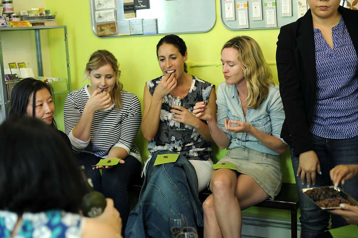 From left, Julia Renda, Kelsey Bowman, Michelle Brasil, and Amy Wicks, members of the marketing team for fashion and shopping website Polyvore, try a selection of chocolates during a tasting event at the Chocolate Garage in Palo Alto, CA Tuesday, August 11, 2015.