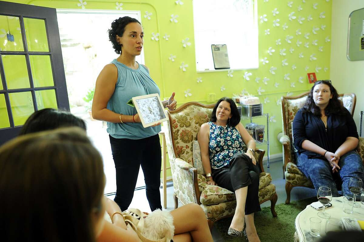 Owner Sunita de Tourreil, left, talks about chocolate production during a tasting event for the marketing team from Polyvore at the Chocolate Garage in Palo Alto, CA Tuesday, August 11, 2015.