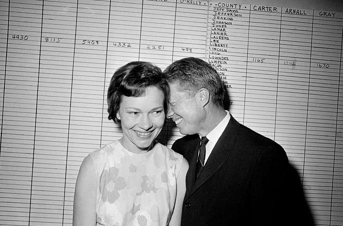 1963:Enters politics as state senator Carter, a Democrat, becomes a Georgia state senator. (Carter and his wife, Rosalynn, are pictured here at a campaign event in 1966)