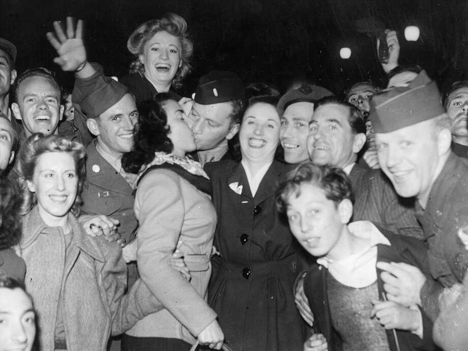 PHOTOS: See the wild parties thrown by Americans across the globe on VJ Day 1945Cheering crowds in Piccadilly during the VJ Day celebrations. Photo: Keystone, Getty Images / Hulton Archive