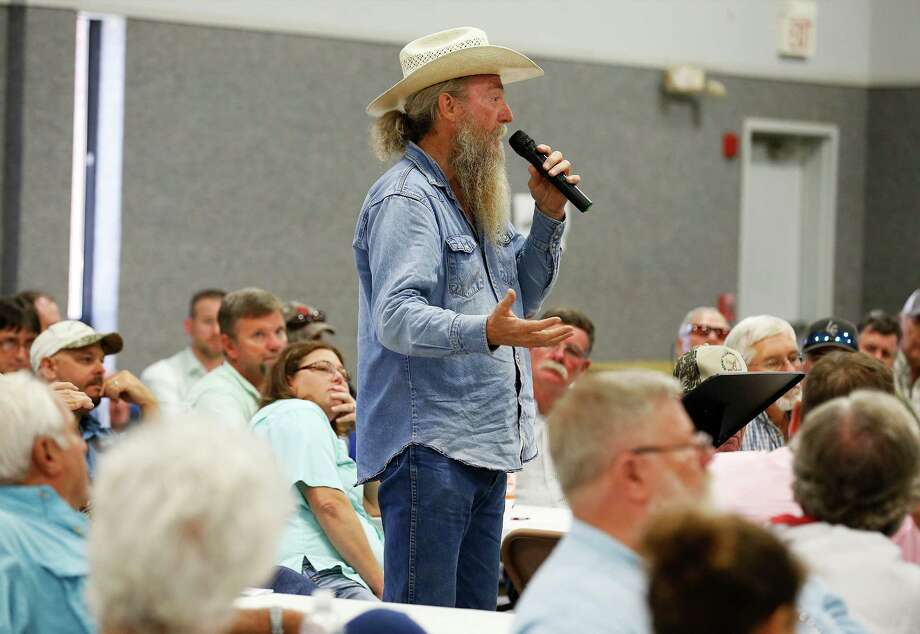 Kerr County resident Rusty Kimbrell, who sells deer hunts on his land, questions the efforts of the state in dealing with chronic wasting disease in the deer population during a meeting at St. Paul's Lutheran Church in Hondo this week. Photo: Kin Man Hui /San Antonio Express-News / ©2015 San Antonio Express-News