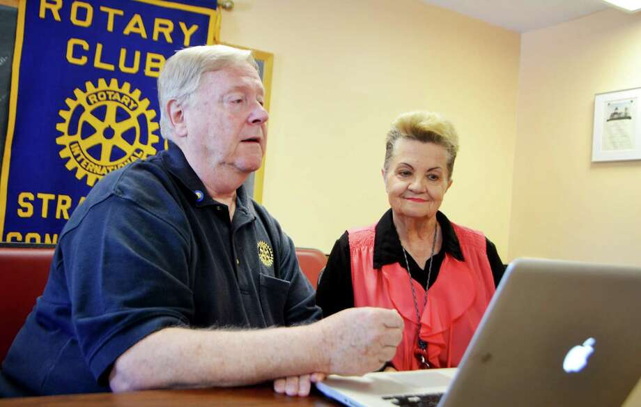 Jack Cratty shows Diane Strode, Stratford resident, how he checks seniors' credit scroes in the Baldwin Senior Center in Stratford, Conn. on Thursday, August 6, 2015. Cratty, a retired police officer and member of the Stratford Rotary Club, offers free credit checks at the Baldwin Senior Center to see if any seniors have been victim to credit scam. Photo: Bailey Wright / For Hearst Connecticut Media / Connecticut Post Freelance