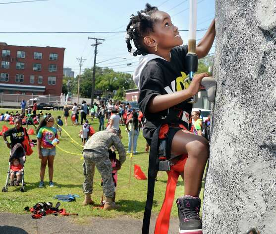Five-year-old Kyra John of Albany climbs the NY Army National Guard Rock Wall during the WORDS Summer of Kindness anti-bullying campaign event at CrossFit Beyond Friday August 14, 2015 in Albany, NY.  .(John Carl D'Annibale / Times Union) Photo: John Carl D'Annibale / 00033006A