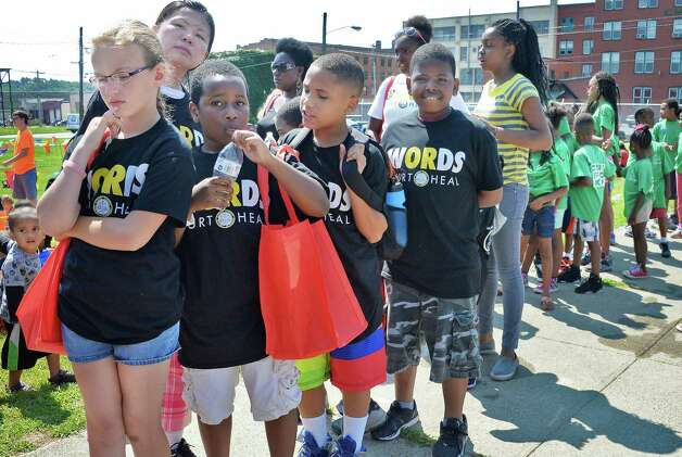 Local children on line for activities during the WORDS Summer of Kindness anti-bullying campaign event at CrossFit Beyond Friday August 14, 2015 in Albany, NY.  .(John Carl D'Annibale / Times Union) Photo: John Carl D'Annibale / 00033006A